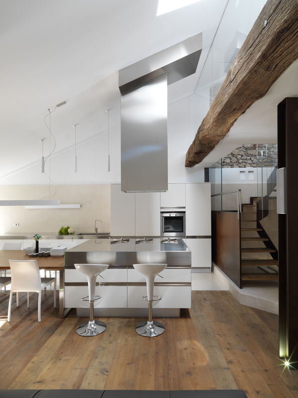 30110279 - view of island modern kitchen with wood floor near to staircase in the penthouse